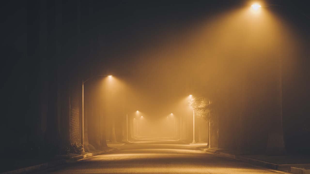 Street lights foggy misty night lamp post lanterns deserted road.