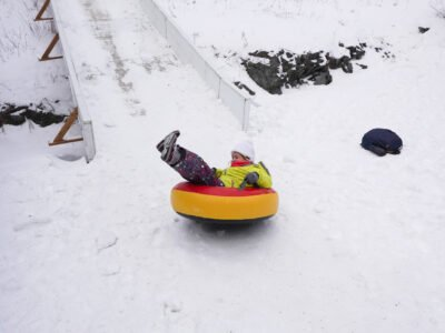Girl in tube on snow